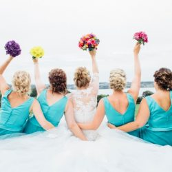 Mexican Travel Theme Wedding Bridesmaids Throwing Bouquets