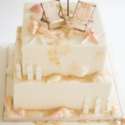 beach shells deckchairs wedding cake